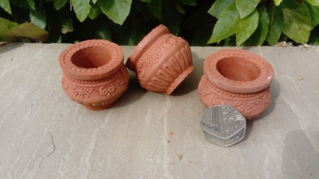Small clay oil lamps shaped like cooking pots